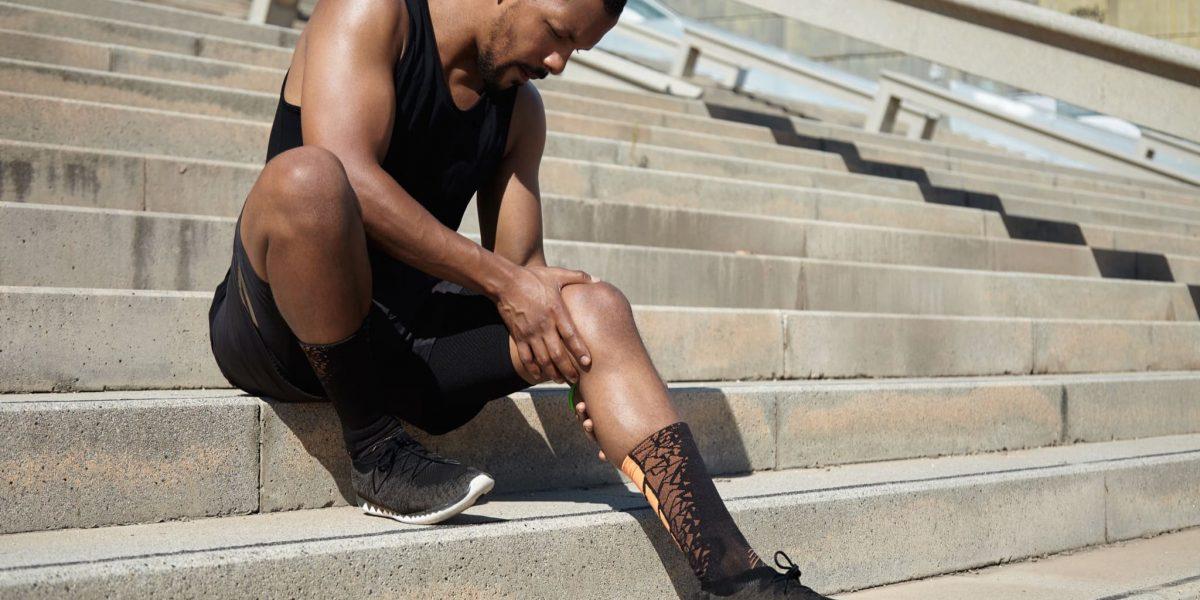 black-male-jogger-in-black-sportswear-and-athletic-V2M9JKJ